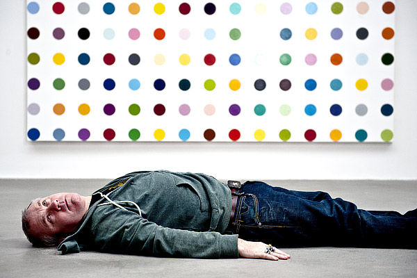 Damien Hirst in front of Spot Paintings
